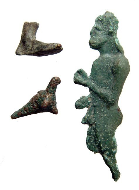 11: Group of Greek bronze votive objects