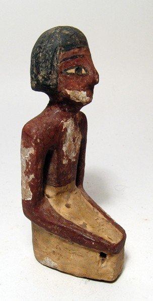 82: Middle Kingdom polychrome wood male figure