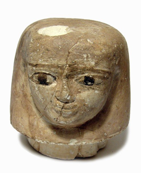 46: Egyptian head of Imsety from a canopic jar