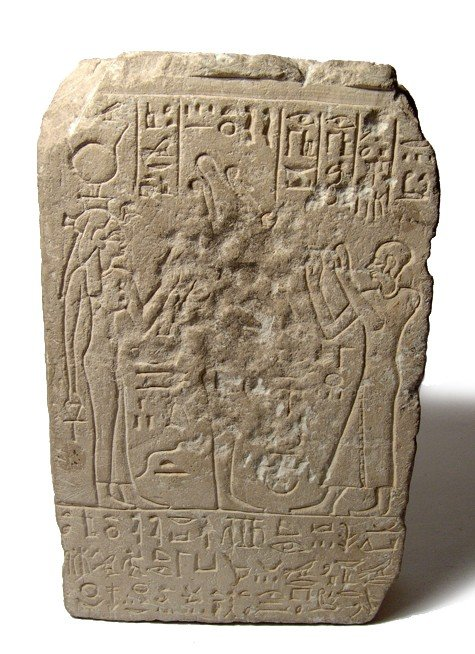 51: Egypt. Limestone relief: Osiris, Isis, and priest