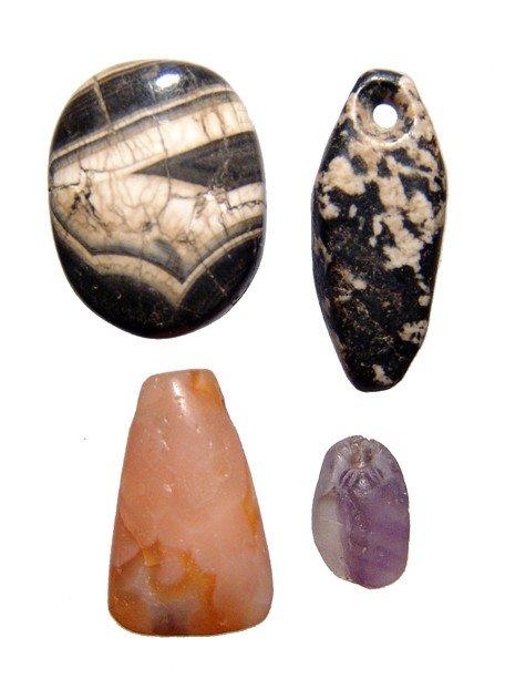 117: Lot of 4 Near Eastern hard stone pendants