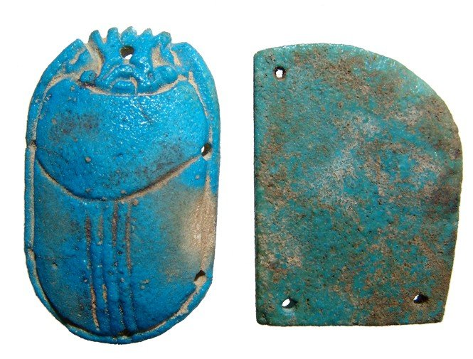 120: Blue faience scarab and wing from a pectoral