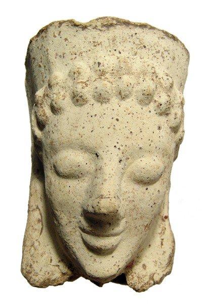 169: Greek  buff terracotta head from a votive