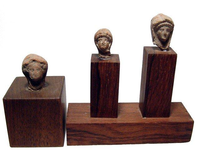 178: 3 Greek mounted terracotta female heads
