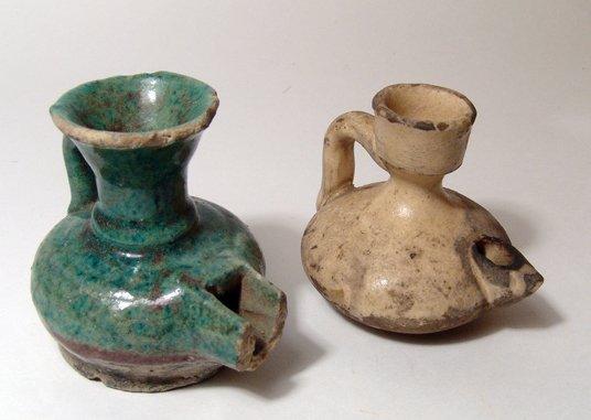 23: Pair of Islamic-era glazed oil lamps