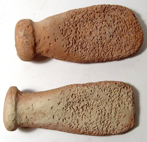 14: 2 Near Eastern terracotta graters or fish scalers