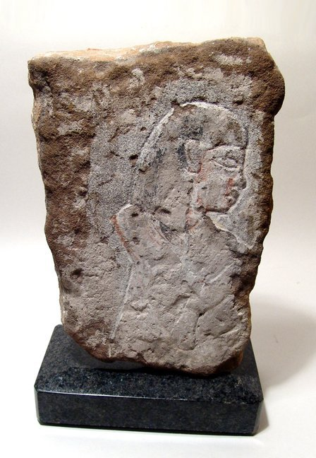 19: Egyptian sandstone relief depicting a male figure