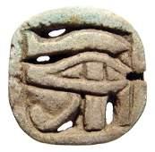 55: Open-work faience 'Eye of Horus' amulet
