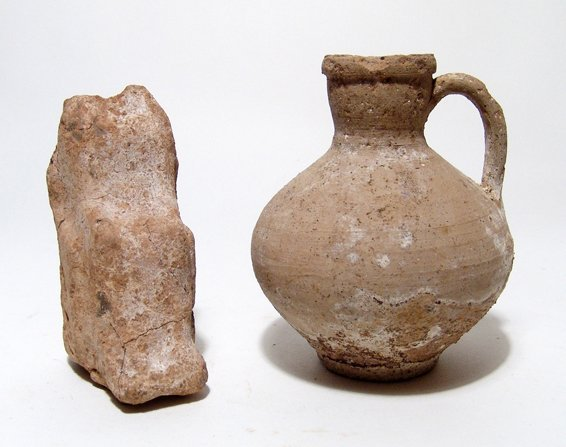 Roman jug and a Greek votive figure