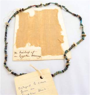 """Egyptian """"mummy linen"""" fragment and necklace"""