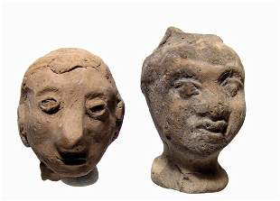 Pair of terracotta heads, Roman and later