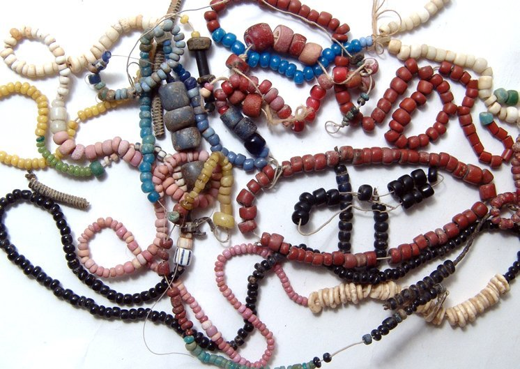 Lot of misc. antique beads, some on strands