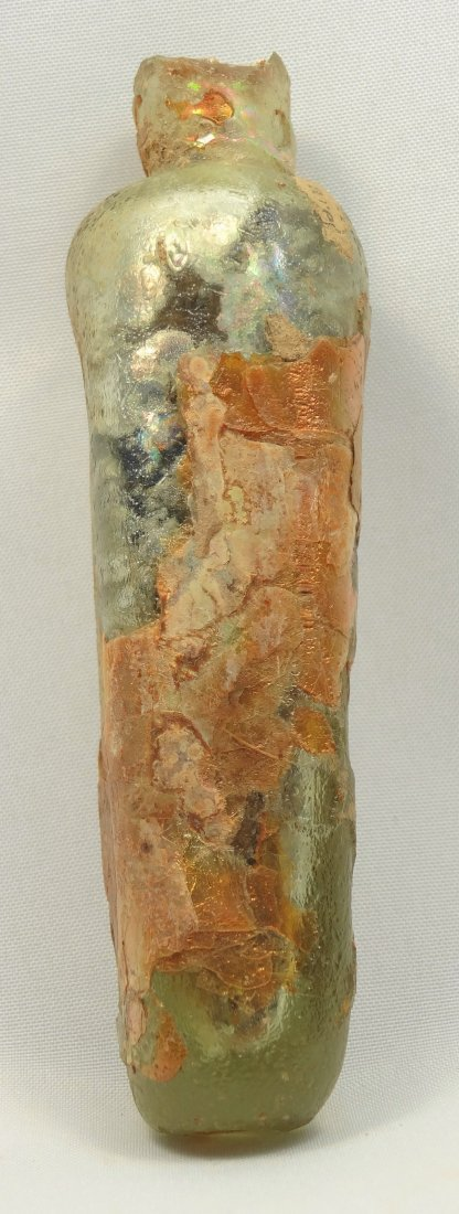 A Roman yellow glass kohl tube