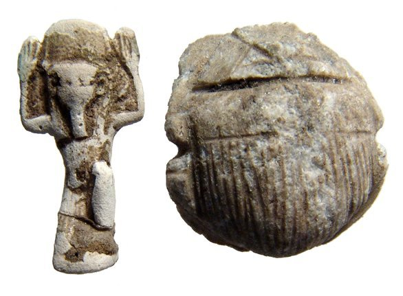A stone scarab and a faience amulet of Shu