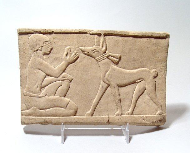 Egyptian Terracotta relief of Man Feeding Dog