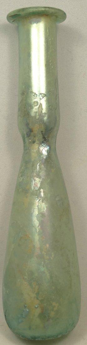 A light blue Roman glass flask