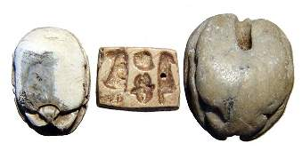 A pair of Egyptian steatite scarabs and a scaraboid