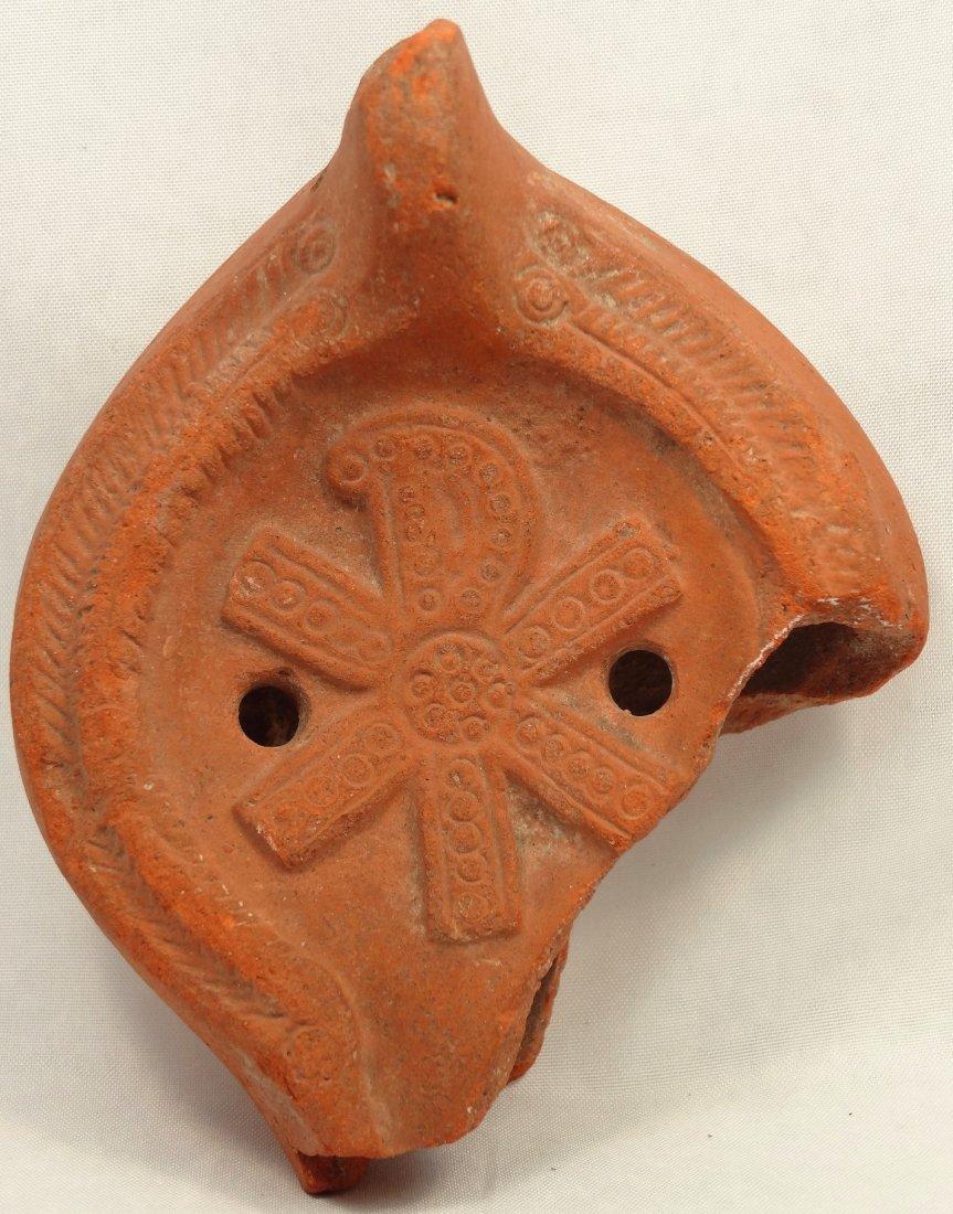 Roman orange terracotta discus lamp