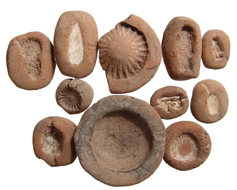 12 New Kingdom terracotta amulet molds