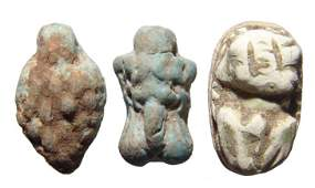 Egyptian faience amulets and a frog scaraboid