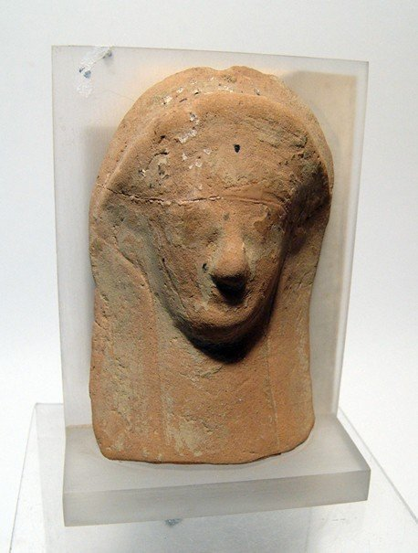 A Greek terracotta female head protome
