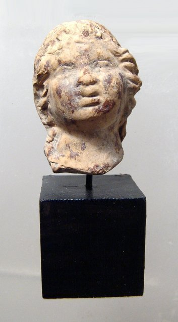 A nice Hellenistic terracotta head of a young woman