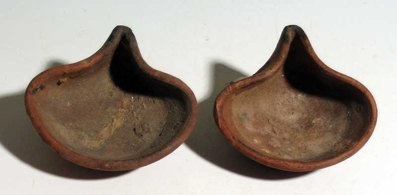 A pair of Iron Age oil lamps