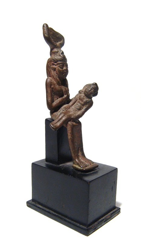 An Egyptian bronze figure of Isis