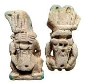 A pair of large faience amulets of the dwarf god Bes