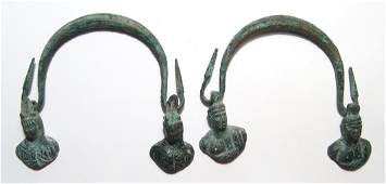 A pair of Roman bronze cauldron handles