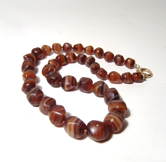 Exceptional strand of 37 striped carnelian beads