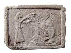 Egyptian limestone plaque with two figures