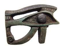 Egyptian faience bicolor Eye of Horus amulet