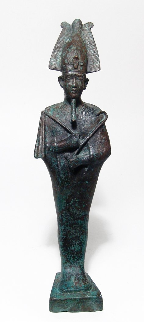 A large and impressive Egyptian bronze figure of Osiris