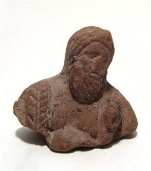 An Egyptian terracotta bust of Herakles