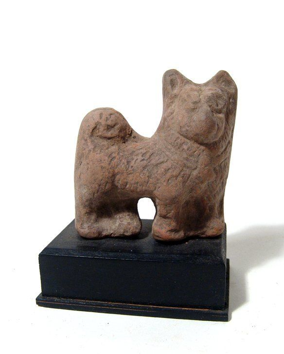 An Egyptian terracotta figure of a Sothic dog
