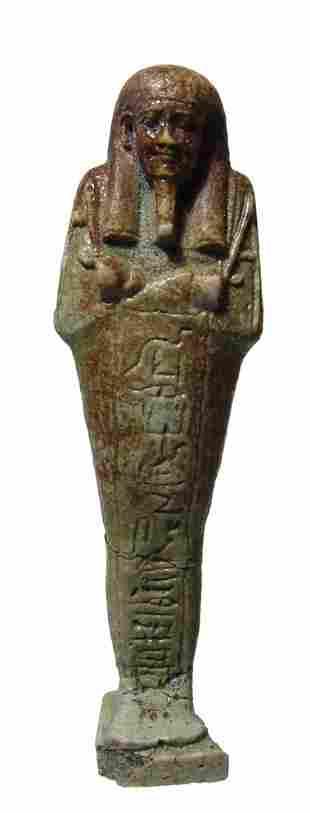 An Egyptian green faience ushabti