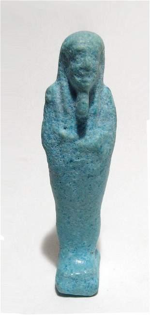 An Egyptian pale blue faience ushabti