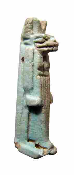An Egyptian faience amulet of Anubis