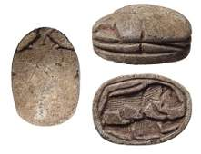 An Egyptian steatite scarab depicting a lion