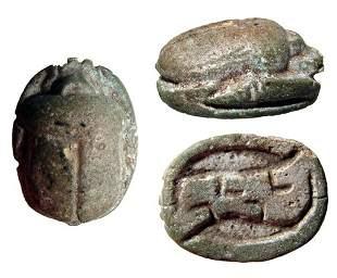 An Egyptian faience scarab with a pair of crocodiles