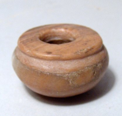 An Egyptian alabaster cosmetic vessel