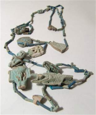 Necklace of Egyptian faience beads and amulets