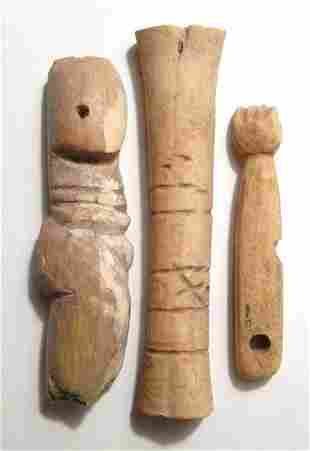 A group of 3 Egyptian bone items