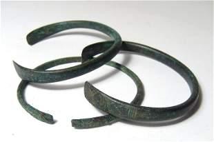 A group of 4 Near Eastern bronze bracelets