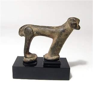 A Near Eastern bronze figure of a roaring lion