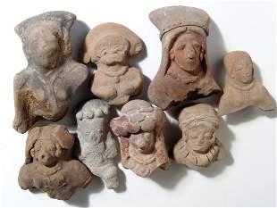 A group of 8 Ecuadoran ceramic heads