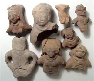 A group of 8 Ecuadoran ceramic busts