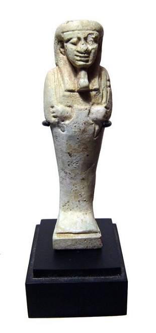 A detailed Egyptian pale green faience ushabti