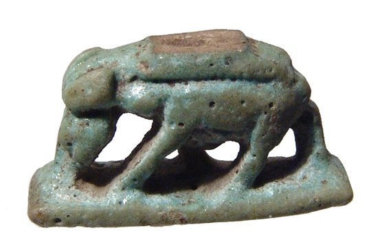 An Egyptian blue-green faience amulet of a sow